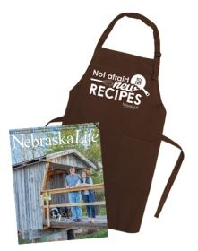 "Combo - ""Not Afraid to Try New Recipes"" Apron + Nebraska Life Subscription"